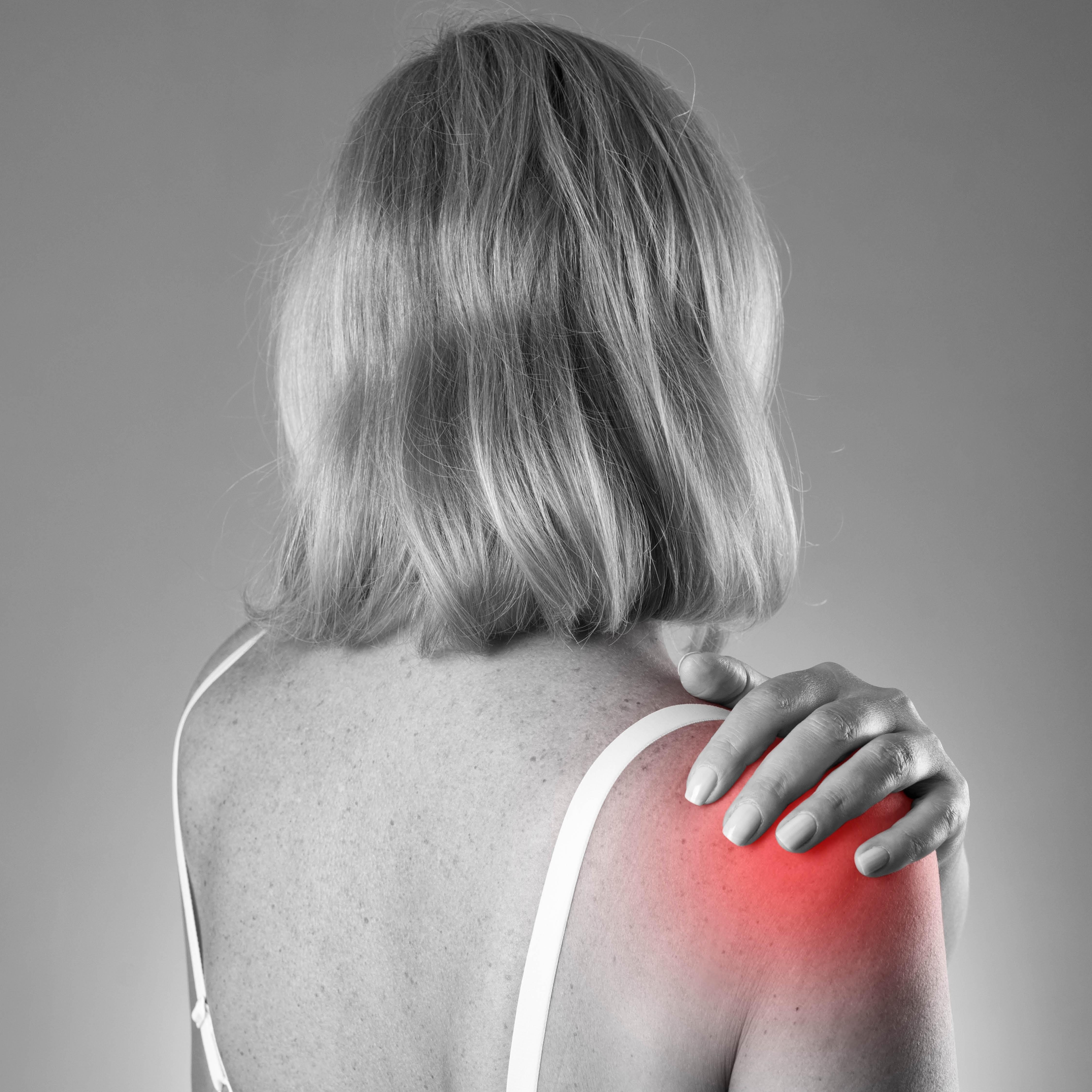 Woman experiencing shoulder pain