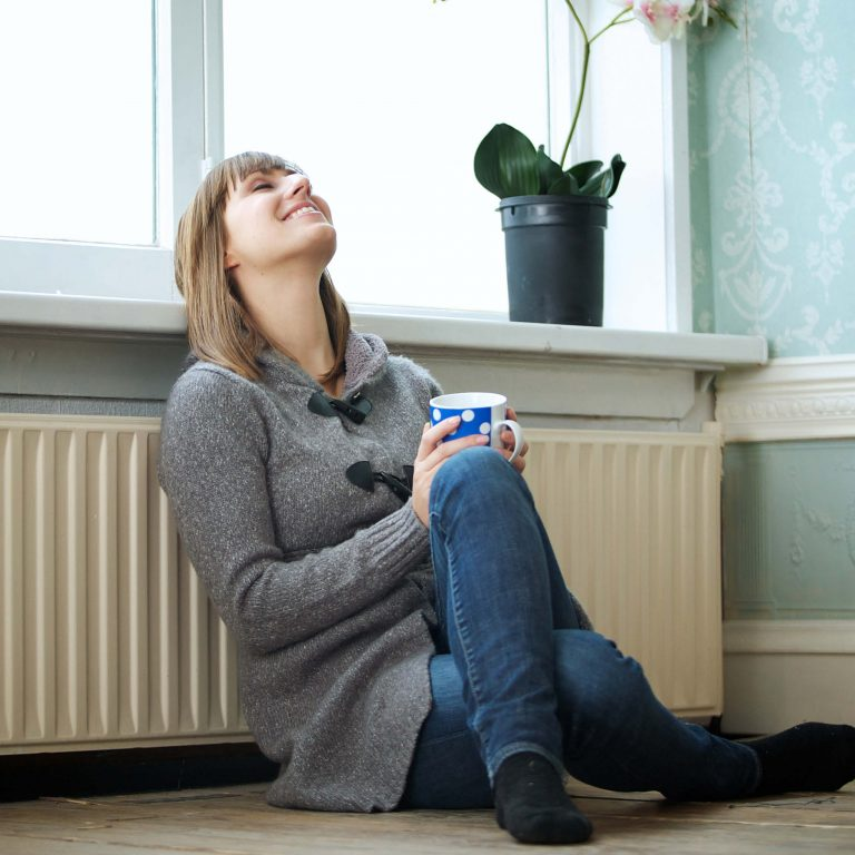 woman enjoying cup of tea